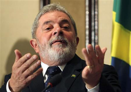 Brazil's President Luiz Inacio Lula da Silva gestures during a news conference with international media in Rio de Janeiro in this December 3, 2010 file photo. REUTERS/Sergio Moraes/Files
