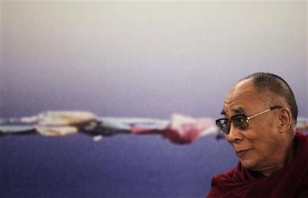 Tibet's exiled spiritual leader the Dalai Lama listens to a journalist's question during a news conference in Sao Paulo September 16, 2011. REUTERS/Nacho Doce