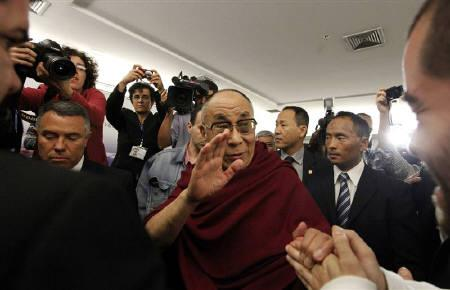 Tibet's exiled spiritual leader the Dalai Lama greets a man after a news conference in Sao Paulo September 16, 2011. REUTERS/Nacho Doce/Files