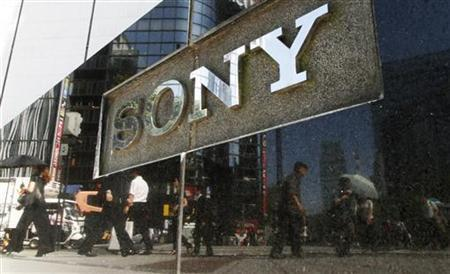 Pedestrians are reflected on a Sony signage in Tokyo June 28, 2011.  REUTERS/Toru Hanai
