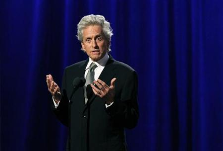 Actor Michael Douglas speaks at the ceremony for the 25th American Cinematheque Award in Beverly Hills, October 14, 2011.   REUTERS/Mario Anzuoni