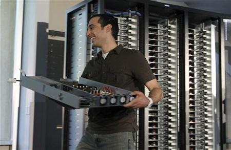 Amir Michael, hardware design manager at Facebook, pulls out the ''open compute program'' server from the racks at Facebook's headquarters in Palo Alto, California April 7, 2011. REUTERS/Norbert von der Groeben