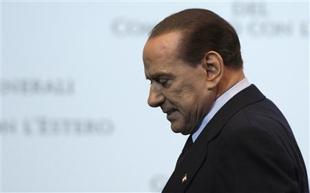 Italy Prime Minister Silvio Berlusconi leaves at the end of a meeting in Rome October 28, 2011.  REUTERS/Remo Casilli