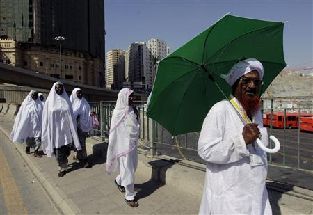 Muslim pilgrims make their way to perform prayers at the Grand Mosque upon their arrival in Mecca, during the annual haj pilgrimage in Mecca October 30, 2011. REUTERS/Ammar Awad