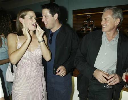 Actress Jennifer Garner greets actors Greg Grunberg (C) and VictorGarber, her co-stars on the television drama series ''Alias'' at a party in Los Angeles Hollywood August 26, 2003.REUTERS/Fred Prouser/Files