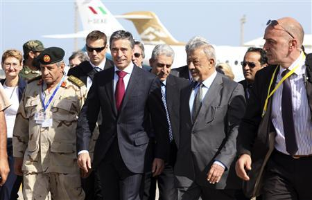 NATO Secretary-General Anders Fogh Rasmussen (front 2nd L) walks beside NTC Defence Minister Jalal al-Digheily (front 2nd R) upon his arrival at Mitiga airport in Tripoli October 31, 2011.  REUTERS/Ismail Zietouny