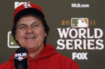 St. Louis Cardinals manager Tony La Russa smiles as he answers reporters' questions during a news conference on a practice day before Game 6 of MLB's World Series baseball championship in St. Louis, Missouri, in this file image from October 25, 2011.   REUTERS/Jim Young/Files