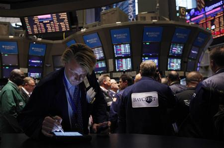 Trader John Bowers works on the floor of the New York Stock Exchange October 31, 2011.       REUTERS/Brendan McDermid