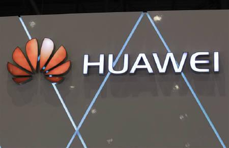 The logo for China-based networking and telecommunications company Huawei is pictured at the ITU Telecom World in Geneva October 24, 2011.  REUTERS/Denis Balibouse