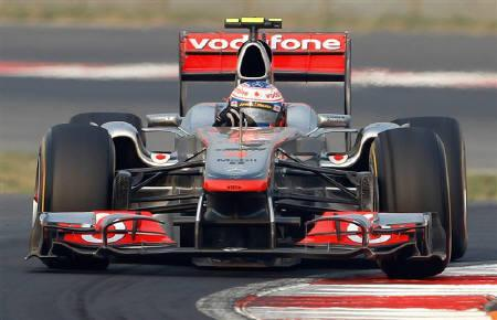 McLaren Formula One driver Jenson Button of Britain drives during the first Indian F1 Grand Prix at the Buddh International Circuit in Greater Noida on the outskirts of New Delhi October 30, 2011. REUTERS/Toru Hanai