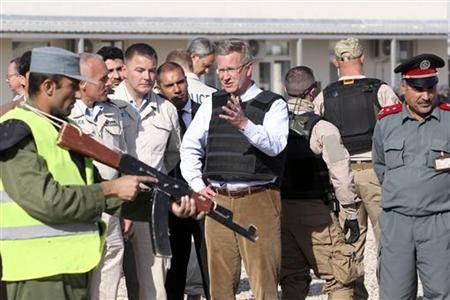 German President Christian Wulff gestures as he visits a police training camp in Mazar-i-Sharif, October 17, 2011.  REUTERS/Wolfgang Kumm/Pool