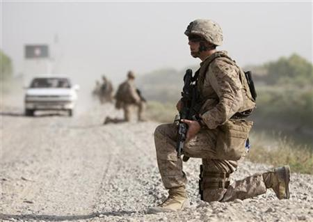 U.S Marines of Weapons Company, 1st Battalion, 3rd Marines patrol outside Camp Gorgak in Helmand province, southern Afghanistan, June 30, 2011.  REUTERS/Shamil Zhumatov