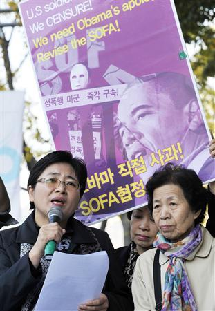 Protesters stage a rally denouncing the crime of U.S. soldiers near the U.S. Embassy in Seoul November 1, 2011. The banner reads, ''U.S. President Barack Obama! Apologize directly!''   REUTERS/Choi Dong-Joon/Newsis