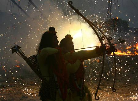 Artists dressed as Hindu Gods Rama and Laxman take part in the Dussehra festival celebrations in Chandigarh September 28, 2009. REUTERS/Ajay Verma/Files