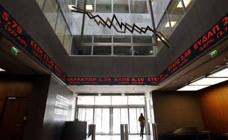 Stock prices are displayed inside the Athens Stock Exchange November 1, 2011.  REUTERS/Yiorgos Karahalis