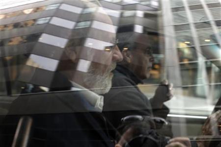Jon Corzine, MF Global Holdings Ltd. CEO, leaves the office complex where MF Global Holdings Ltd have an office on 52nd Street in midtown Manhattan, October 31, 2011. REUTERS/Brendan McDermid
