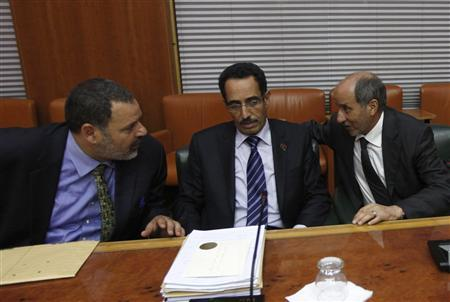 National Transitional Council (NTC) Chairman Mustafa Abdul Jalil (R) speaks with his deputy, Abdul Hafiz Ghoga (C), and an unidentified official before the vote for Libya's new interim prime minister in Tripoli October 31, 2011. REUTERS/Ismail Zitouny