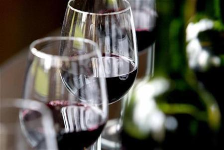 Glasses and bottles of Chateau Belcier red wine (Saint Emilion label) are seen in a testing room in Saint Emilion, southwestern France, November 6, 2007.   REUTERS/Regis Duvignau
