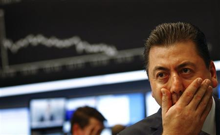Share trader Robert Halver reacts as the German share prize index DAX reaches a six percent loss during the afternoon trading session at Frankfurt's stock exchange November 1, 2011.  REUTERS/Kai Pfaffenbach