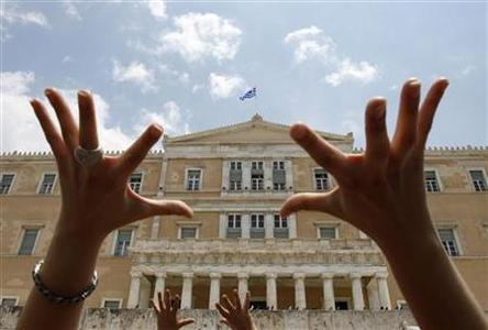 Protesters gesture in front of the Greek parliament during a rally against government austerity measures in Athens June 29, 2010.   REUTERS/John Kolesidis