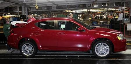 A 2011 Dodge Avenger moves down the assembly line at Chrysler's Sterling Heights Assembly in Sterling Heights, Michigan December 6, 2010.   REUTERS/Rebecca Cook