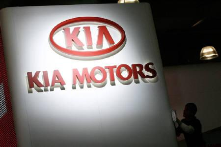 A sign for automaker Kia Motors hangs at the 2008 New York International Auto Show March 19, 2008.  REUTERS/Keith Bedford/Files