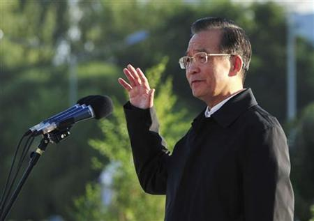China's Premier Wen Jiabao gestures as he delivers a speech before the launch of China's unmanned space module Tiangong-1 in Jiuquan Satellite Launch Center, Gansu province September 30, 2011. REUTERS/China Daily
