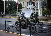 <p>Security make their way down the promenade near the festival palace in Cannes, southern France November 1, 2011. REUTERS/Dylan Martinez</p>