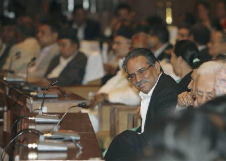 United Communist Party of Nepal (Maoist) chairman Pushpa Kamal Dahal Prachanda smiles during the voting procedure of the Constituent Assembly term extension at the Parliament in Kathmandu August 29, 2011. REUTERS/Navesh Chitrakar/Files