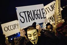<p>An Occupy Wall Street protestor wearing a Guy Fawkes mask takes part in the 39th Annual Halloween Parade in New York, New York October 31, 2011. REUTERS/Andrew Burton</p>