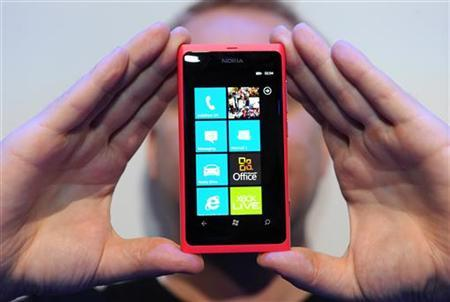 The new Nokia smart phone Lumia 800 is shown off at Nokia world, London, October 26, 2011. REUTERS/Paul Hackett