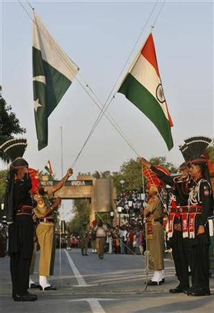 Pakistani Rangers (in black) and Indian Border Security Force (BSF) lower their respective country flags during the daily parade at the Pakistan-India joint check-post at Wagah border, on the outskirts of Lahore May 11, 2010. REUTERS/Mohsin Raza
