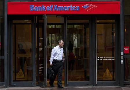 A Bank of America customer leaves a banking branch in Charlotte, North Carolina October 13, 2011.  REUTERS/Chris Keane