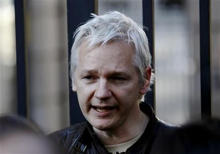 WikiLeaks founder Julian Assange speaks to protesters outside St Paul's Cathedral, next to the London Stock Exchange,  in central London October 15, 2011. REUTERS/Luke MacGregor