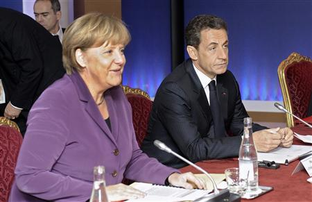 France's President Nicolas Sarkozy and Germany's Chancellor Angela Merkel attend crisis talks in Cannes on the eve of the G20 summit, November 2, 2011. REUTERS/Christophe Karaba/Pool