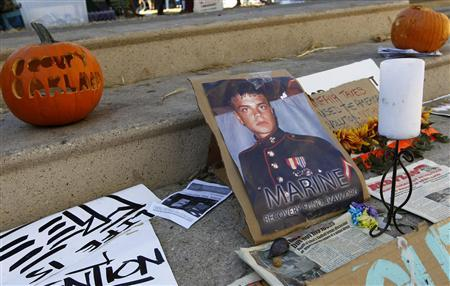 Signs and pumpkins are displayed for former U.S. Marine Scott Olsen, who was injured in last week's Occupy Oakland protests, near Frank Ogawa Plaza in Oakland, California November 1, 2011.  REUTERS/Robert Galbraith
