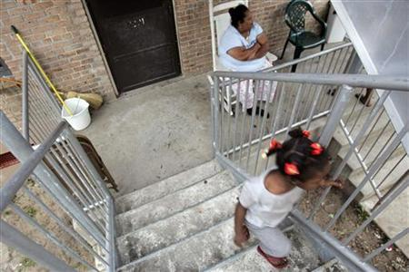 A girl walks up stairs at the B.W. Cooper housing project in New Orleans, Louisiana November 5, 2006.  REUTERS/Lee Celano