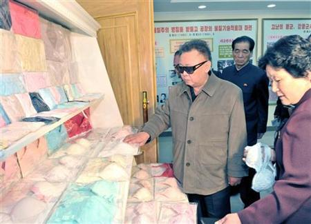 North Korean leader Kim Jong-il (C) visits the Rakrang Ponghwa Garment Factory in Pyongyang in this picture released by the North's official KCNA news agency May 7, 2011. KCNA did not state expressly the date the picture was taken.       REUTERS/KCNA