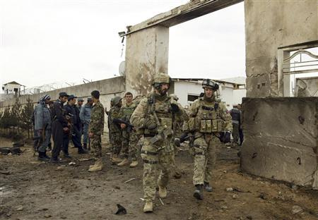 U.S. and Afghan troops arrive at the site of a suicide attack in Herat November 3, 2011. REUTERS/Mohammad Shoib