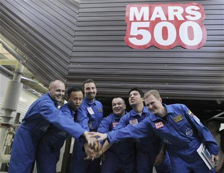 In this file photo, participants of the Mars500 experiment, which simulates a 520-day flight to Mars, pose for a picture before entering a confinement module to start their mission in Moscow June 3, 2010. The crew comprises of (L-R): Alexey Sitev, Wang Yue, Romain Charles, Sukhrob Kamolov, Diego Urbina and Alexander Smoleevskiy. REUTERS/Sergei Karpukhin
