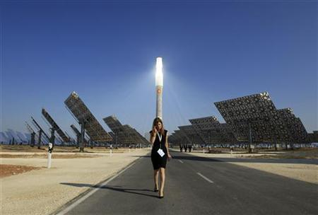 A woman walks at the new solar power plant ''Gemasolar'' the day of its inauguration in Fuentes de Andalucia, southern Spain October 4, 2011.  REUTERS/Marcelo del Pozo