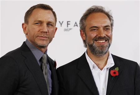 Actor Daniel Craig and director Sam Mendes (R) pose while launching the start of production of the new James Bond film ''SkyFall'' at a restaurant in London November 3, 2011. REUTERS/Luke MacGregor