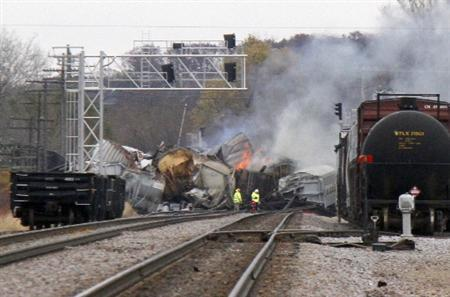 Several cars from a Canadian National freight train are seen on fire after they derailed between the Chicago suburbs of Bartlett and Elgin, Illinois, November 3, 2011.  REUTERS/Frank Polich