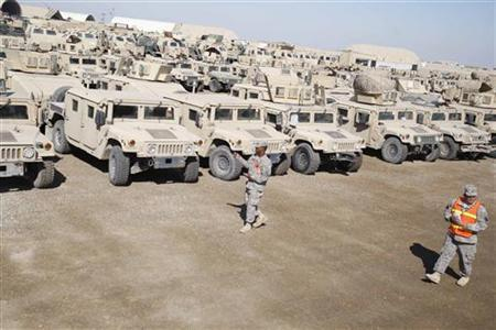 U.S. soldiers check military vehicles that would be shipped, as troops prepare to pull out of a military base in Nassiriya, about 300 km (185 miles) southeast of Baghdad November 3, 2011.  REUTERS/Atef Hassan