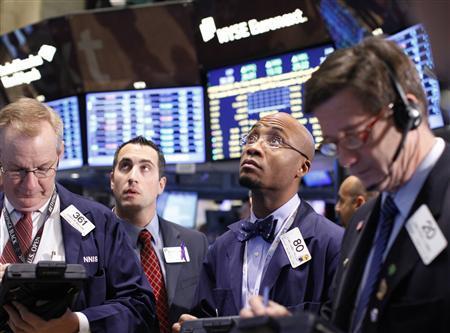 Traders work on the floor of the New York Stock Exchange, November 2, 2011. REUTERS/Brendan McDermid