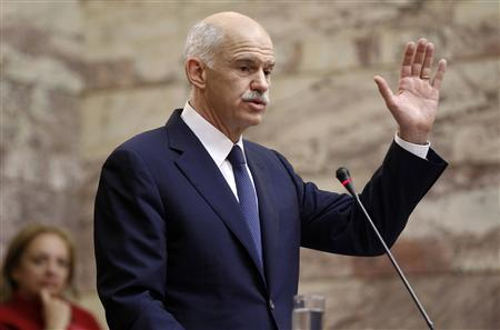 Greek Prime Minister George Papandreou delivers a speech to socialist lawmakers from his party in Athens November 3, 2011. REUTERS/Yiorgos Karahalis