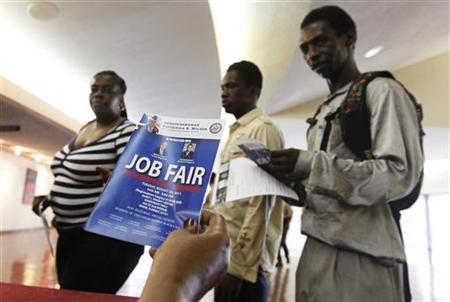 Job candidates receive information as they enter a Jobs Fair in Miami, Florida August 23, 2011. REUTERS/Joe Skipper