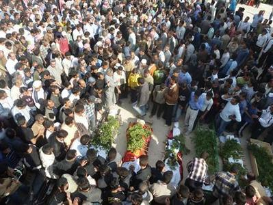 Anti-government protesters attend the funeral of Sunni Muslim villagers killed on Wednesday, in Hula near Homs November 2, 2011.  REUTERS/Handout