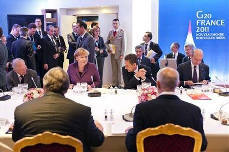 France's President Nicolas Sarkozy (3R), Finance Minister Francois Baroin (R) and German Chancellor Angela Merkel and Finance Minister Wolfgang Schaeuble (L) meet with Greece's Prime Minister George Papandreou (2R) and Finance Minister Evangelos Venizelos (2L) for crisis talks before a G20 summit of major world economies in Cannes, November 2, 2011.    REUTERS/Bundesregierung/Guido Bergmann
