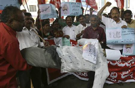 Activists from the Communist Party of India (CPI) shout slogans and burn an effigy depicting oil minister S. Jaipal Reddy during a protest against the hike in petrol prices, in Hyderabad November 4, 2011. REUTERS/Krishnendu Halder/Files